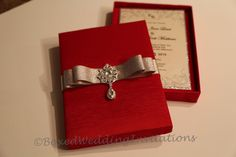 A personal favorite from my Etsy shop https://www.etsy.com/listing/225539749/dangling-crystal-wedding-invitation-box