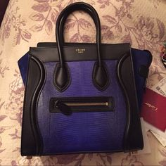 RARE Celine Mini Blue Lizard Skin suede Bag NWT RARE NWT Celine Mini Luggage Bag. Never been used, new with tags! Purchased at Barneys in San Fransisco, and is made of Lizard Skin and dark blue suede with gold accents and black leather. Celine Bags