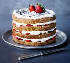 A light vanilla sponge dotted with seeds and sandwiched with orange frosting and fresh strawberries - heavenly