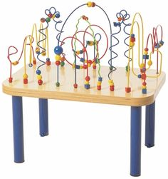 Airport attendants tell us that the Monster Mountain Table is the perfect activity to encourage cooperative play with as many as 6 children at one time. With 104 wooden beads gliding over 10 play wires that have been secured into a solid Baltic Birch table top; there are no removable parts.