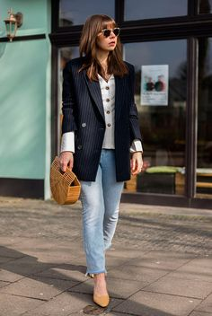Navy stripe blazer, white button-down top, raw hem jeans, yellow heels, round sunglasses, bamboo clutch. Fashion 2018, spring fashion, spring style, spring outfit, casual spring outfit, casual outfit, blazer outfit, jeans outfit, fashion trends 2018, spring fashion trends 2018, street style. #fashion2018 #springstyle #ss18 #casualstyle #streetstyle #ootd #whatiwore #blazer #outfits #outfitideas #outfitinspiration #bedazelive #blazer #blazeroutfit #ootd #springfashion