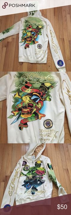 Stunning Ed Hardy Hoodie In perfect condition brand new. The base color is a pale yellow with multi colored front and back Ed Hardy Tops Sweatshirts & Hoodies