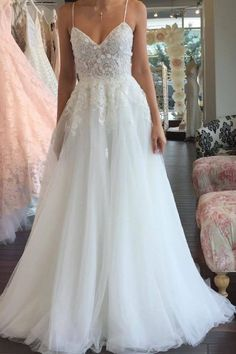 A Line Spaghetti Straps V Neck Floor Ivory Tulle Beach Wedding Dress with Appliq. - A Line Spaghetti Straps V Neck Floor Ivory Tulle Beach Wedding Dress with Appliques Source by - Spaghetti Strap Wedding Dress, Wedding Dresses With Straps, Wedding Dresses 2018, White Wedding Dresses, Spaghetti Straps, Gown Wedding, Lace Wedding, Elegant Dresses, Rustic Wedding