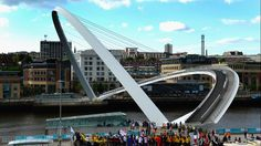 The Millennium Bridge, a pedestrian and cyclist bridge spanning the River Tyne in England, is the world's first and only tilting bridge. Two large hydraulic rams at each side tilt the structure back allowing boats to pass under. It takes approximately four minutes to rotate the weight of the structure to its fully open position. (Stu Forster/Getty Images)