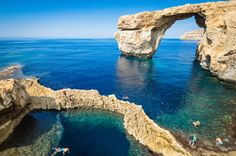 Photo about The world famous Azure Window in Gozo island - Mediterranean nature wonder in the beautiful Malta - Unrecognizable touristic scuba divers. Image of coastline, malta, mediterranean - 45869464 Malta Beaches, Malta Gozo, Malta Island, Filming Locations, Travel Couple, Mykonos, Lonely Planet, Where To Go, The Good Place