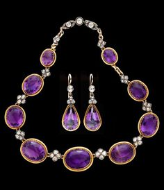 An antique silver, gold, amethyst and diamond demi parure, French, circa 1893. Comprising a necklace and a pair of earrings, with French assay marks.