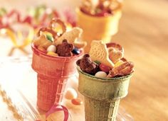 Looking for easy kid's birthday food? A no-bake snack mix in one of their favorite dessert containers (colorful ice cream cones) couldn't get any easier! Just throw together some Teddy Grahams, pretzels, animal crackers, M's, yogurt covered raisins, and anything else your kiddos love to munch on.