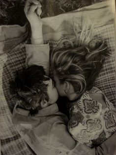 I cringe, seeing that I'm snuggled up against Treys warm body like he's an oversized teddy bear. My head is just below his chin and his arm is resting on my hip as we're turned toward each other like....lovers. Under Different Stars.