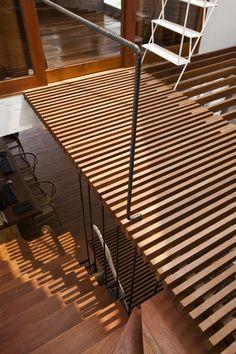 a21house. wood slat floor/ceiling. rebar banister