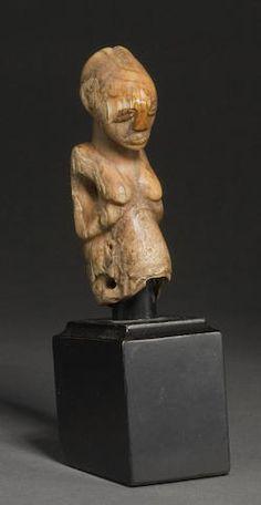 A Luba ivory amulet