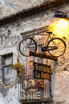 Bicycle used above a travern sign in Tropea, province of Vibo Valentia, Calabria region Italy