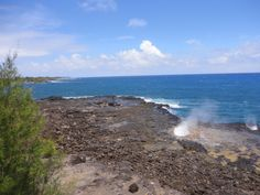 South side of Kauai at Spouting Horn. It's hard to catch this baby right on time. Legend has it that a boy named Liko tricked the giant lizard Kaikapu into following him into a lava shelf. The boy got out, the lizard is still stuck and the noise from the blowhole is the lizard's roar.