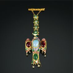A Qajar enamelled and gem-set gold pendant in the form of a bird, Persia, 19th century | lot | Sotheby's