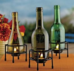 Love this...would drill holes in the bottles, too, so I could put tealights in the bottom and tapers in the top...  Neat on the patio!