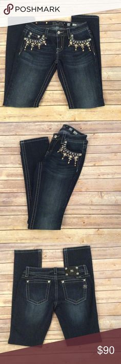 """HP NWOT Miss Me Jeans Size 28 Signature Straight  Host Pick for the Casual Friday Party 9-2-16 Chosen by @tamarismom ❤️ NWOT Miss Me Blue Jeans Signature Straight Size 28. Measurements laying flat: Waist 15"""", Rise 7"""", Inseam 33.5"""". Gorgeous Rhinestone Details on front pockets and Rhinestone Studs  on back pockets.  NO TRADES AND PRICE IS FIRM Miss Me Jeans Straight Leg"""