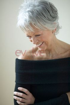 The beauty of an unfrozen face and soft gray hair. by Eva