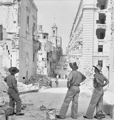 Australians looking at the Devastating ruins caused by Nazi air raid in Valletta 1943