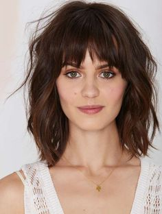 Wavy piecy bob with bangs, brunette