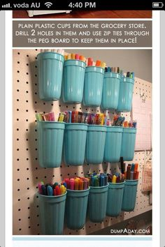 Organise pens, pencils, paint brushes, testers, scissors etc in cups on peg board at the back of a desk - easy to reach, easy to find what colour you need :)