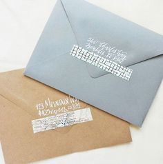 Use washi tape as wedding invite envelope enclosures.