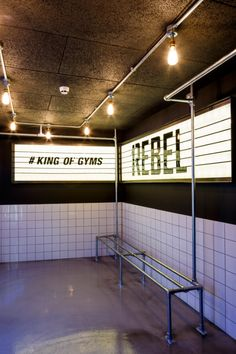 Studio C102 gives 1Rebel gym a clubby air with industrial-style detailing - News - Frameweb