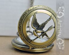 Vintage style Pocket Watch Locket Necklace with the hunger games mockingjay cover
