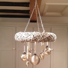 Hanging wreath adorned with mercury glass decorations www.theroundedhouse.com