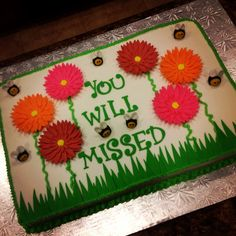 Going away cake!   Flowers and bumble bees.