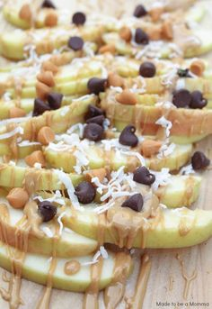 Apple Nachos covered in peanut butter, chocolate chips and coconut create the perfect after school snack to share with your kids.