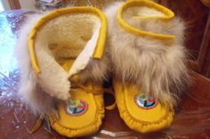 Deer hide moccasins lined with imitation sheep skin and Coyote fur $240.00, contact Janine at janine.charlton@yahoo.com