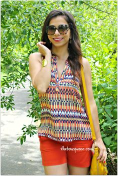 I love this outfit. Bright colors with pop of color shorts