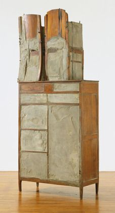 """Doris Salcedo (Colombian, born 1958)  Untitled 1995  Wood, cement, steel, cloth, and leather, 7' 9"""" x 41"""" x 19"""" (236.2 x 104.1 x 48.2cm). Commemorates individual victims of the protracted violence and civil war in her native Colombia."""