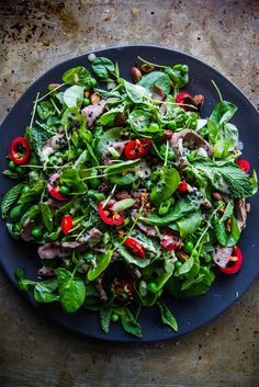 Sesame Steak Salad - with fresh herbs, sweet peas, spicy chilis, crunchy almonds, and ginger tahini... yum!