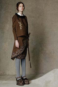 Fall 2014. Gary Graham. love this velveteen brown and gold embroidered suit with fur trim collar,ethnic,boho,but simple lines