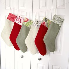 Set of Six Burlap Christmas Stocking with Designer Fabric Cuff in Red Green and Ivory. $192.00, via Etsy.