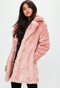 7d44825863 Pink slim coat featuring faux fur fabric, clasp fastening, two front  pockets and full lining.