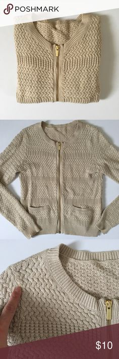 Zippered Cardigan- Textured Beige SUPER SOFT. Beige textured Cardigan with gold zipper and two patch pockets. This sweater is super chic and fitted. Tiny mark on shoulder as shown. This was my mom's she removes all tags. NO TAGS priced accordingly. Sweaters Cardigans