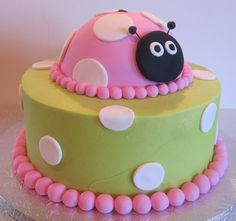 Lady Bug Cake. This one is simple....would be super easy! Grass green base then red and black!