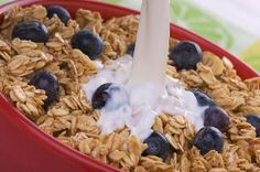 Granola is a cereal-like combination of oats and other grains, often with nuts and dried fruits. A good source of protein, carbohydrates and fiber, granola is an excellent energy-giving food that also can be added desserts and baking. MayoClinic.com notes that some commercial brands may have added fats and sugars, making it high in calories. You can make your own granola or look for healthier varieties.