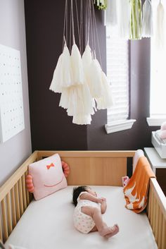 Modern girls nursery - love this modern fringe mobile idea.  SO cute