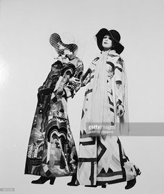 Twiggy and Patti Boyd wearing ankle-length coats with bold geometric patterns and broad-brimmed floppy hats, circa 1972. Taken in Milan for Italian Vogue.