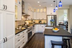 Traditional Kitchen with Zephyr 36 Inch Europa Wall Mount Range Hood, L-shaped, Kitchen island, Breakfast bar, Flush