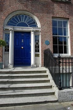 royal blue door, fan light, side lights & columns- perfect!