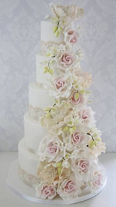 While Kate Middleton may have inspired more brides to have lace covered cakes to match their dress, this year's trends include the more quirky — oversized flowers, metallic and ombre shades, naked cakes, ruffles galore and much more