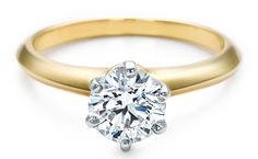 Tiffany's 1Ct. 18kt gold engagement ring. So pretty and simple setting, if a touch over the top.
