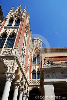 Photo made at the coffee Pedrocchi in Padua in Veneto (Italy). In the image, taken from near and under the famous cafe she said no doors, you see, the part facing south and sunlit. In the foreground you can see the white columns and then the part of many small Gothic spiers that seem to pierce the blue sky.