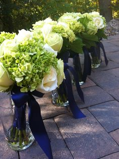 Navy and green wedding, green bouquets, green hydrangea, cream roses, navy bridesmaid dresses,