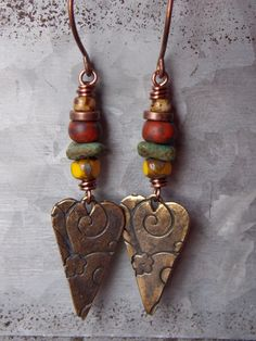 Hand forged copper earwires are complemented with a rustic assortment of Czech…