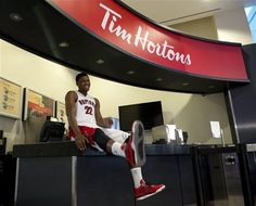 400218faa14a Toronto Raptors Rudy Gay (22) kicks up his feet as he waits to pose