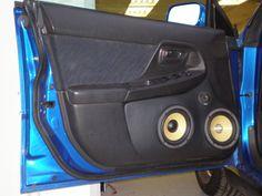 Custom door pods with a Focal 3wy speaker system in a Subaru WRX wagon.
